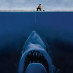 Картинка Мужчина рыбачит и на его приманку смотрит акула анимация