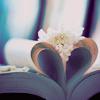 Смайлик Страницы книги сложены в сердечко. а поверх лежит цветок аватар